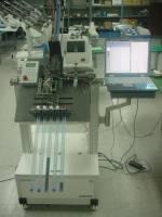 Programtor Uprog pracający na automacie do programowania układów scalonych w jednym z koerańskich koncernów elektronicznych